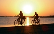 A photo of cycling in Formentera at sunset by lake